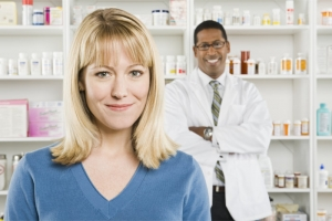 pharmacist and patient smiling